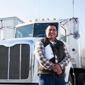 Truck driver standing near truck